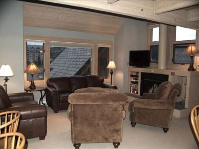 Big Sky chalet rental - Wood fireplace with wide views of Lone Peak, the ski base & Spanish Peaks Mt