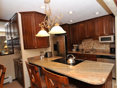 Dillon condo rental - Bar and wine fridge completes the kitchen and dining area.