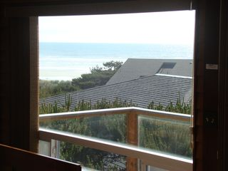 Waldport house photo - A view of deck with glass panels. We see right over the top of the house below.