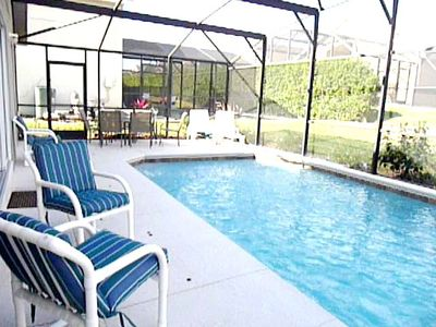 HEATED pool with cover for cool nights (a must in Orlando). Loungers and dining