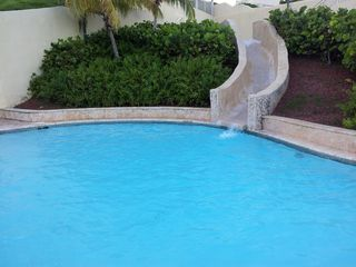 Fajardo condo photo - Pool with a water slide with shower and bathroom for him and her an