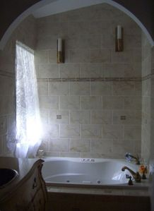 Jacuzzi jetted tub in master bathroom