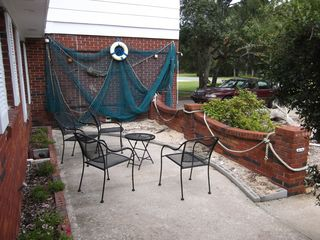 Jekyll Island house photo - Front patio with beach. A place to put your leftover shells or take a few home.