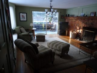 North Conway house photo - First living room with fireplace, window seat and attached solarium