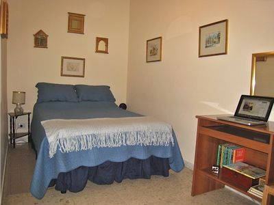 The second bedroom has a full-sized bed.Books and games. Laptop not included.