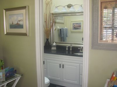 Guest Bathroom with tub/shower, and granite counter top