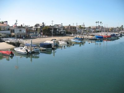 Beach, boats, and broadwalk surrounding Balboa Island
