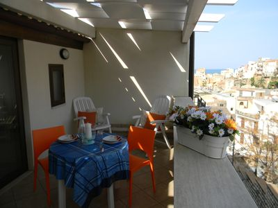 Apartment in the center, well-appointed, with a beautiful veranda, wi-fi