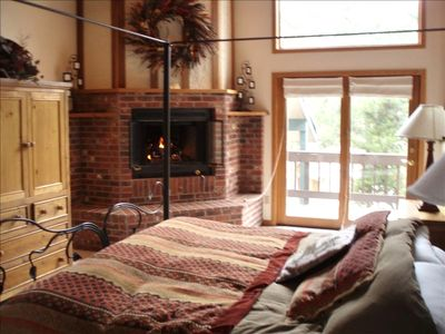 Beautiful Master Bedroom with Gas Fireplace and Balcony Views for the Mountain