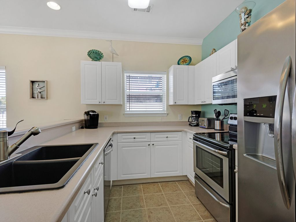 Nice open kitchen with all new stainless steel kitchen appliances.