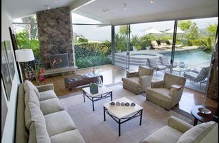 Hollywood estate photo - Formal Living Room - 10 ft walls of glass overlooking pool, spa and view.