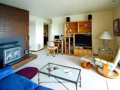 Lower Level Family room - Lower family room has a deluxe queen-size sofabed, wood stove, computer desk with DSL, and flat screen TV.