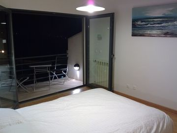 Bedroom at night onto balcony