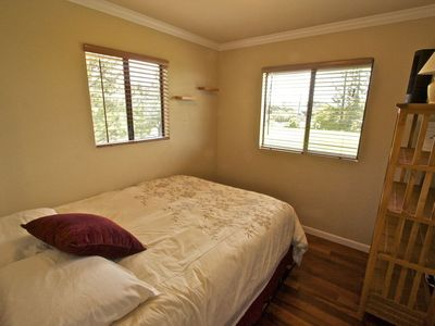 Second Bedroom has mountain views and a very comfortable Queen Bed