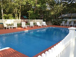 Hampton Bays house photo - The clear and glistening pool is seperately fenced.