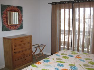 Carolina Beach condo photo - Guest bedroom with king sized bed overlooking the harbor