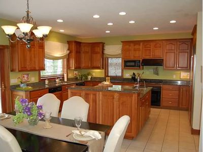 gourmet kitchen, with enormous granite island with bar seating