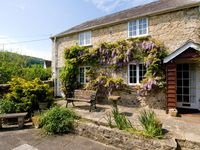 A wisteria clad cottage in the heart of Branscombe village and pet friendly
