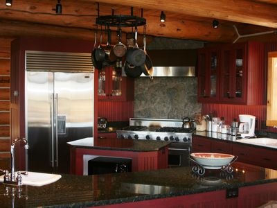 Gourmet Kitchen with Viking Range, Stainless Steel Refrigerator/Freezer.