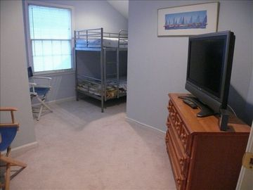 Bedroom # 5 with bunkbeds for the kids. There is also TV & couple chairs.