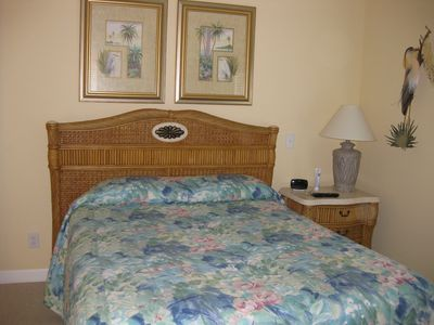 Master bedroom has queen bed, whirlpool tub/shower, double vanity and 32 inch TV