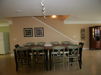 Dining table showing all seating at table. The table seats 10-12.