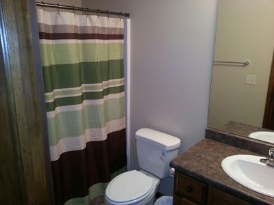 one of two full bath with tub and shower on second level