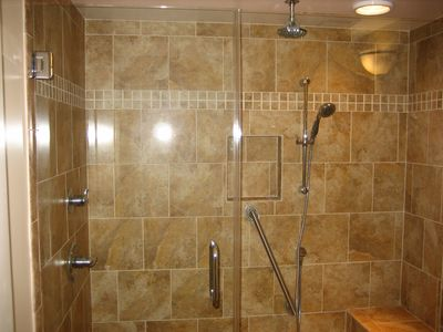 Enjoy the rainhead in the new shower.
