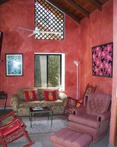 Casa Oasis has a large and airy living room with cable TV provided.