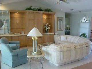 Vacation Homes in Marco Island house photo - Entertainment center with cable tv and Bose surround sound system.