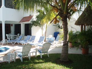 Cozumel apartment photo - A view from the grassy area of the garden toward the villa.