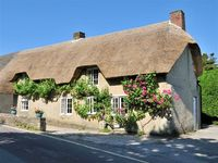 Thatched cottage at Studland Bay close to beach on World Heritage site