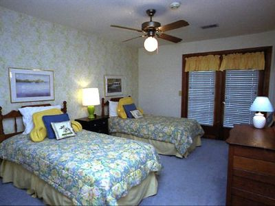 Upstairs south-middle bedroom with two twin beds, full bath and balcony BR (5).