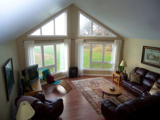 Miminegash cottage photo - Sunny, comfy living room with a view of the ocean, yard and room for everyone.