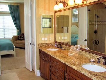 Master bath with large walk in closet and huge countertop of granite!