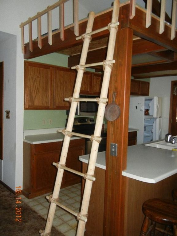 Ladder to loft above kitchen - kids will love this! Railings provide safety.