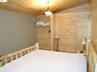 Burt Lake cabin photo - Comfy, Custom King size log bed in Master bedroom...