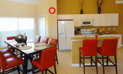 Dining Area and fully equipped kitchen with breakfast bar