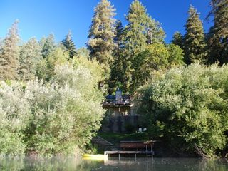 Russian River house photo - View of dock, lower yard and house from river