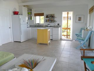 Staniel Cay cottage photo - Kitchen area and open front door.
