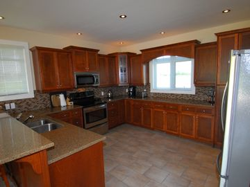 Kitchen with all necessary appliances and cookware