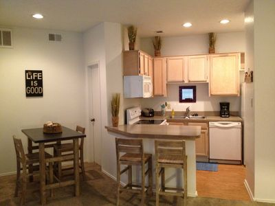 Dining and Kitchen. Enjoy a home cooked meal in the dining area.