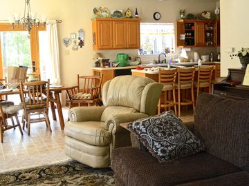 The living and dining area is perfect for large family gatherings.