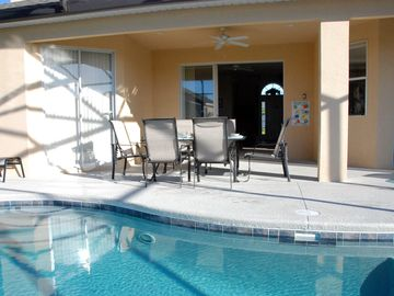 Covered Lanai & some of the luxury poolside furniture & heated 28 ft pool