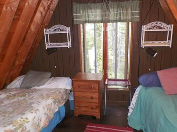 The twin beds upstairs in the A frame
