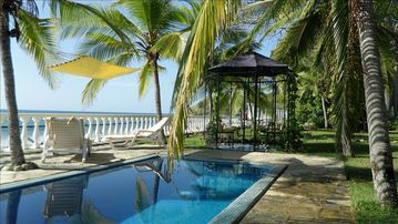Playa Palmar house rental - view of pool and gazebo next to the ocean front