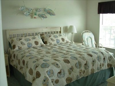 Manteo condo rental - Master Bedroom with a view of the tennis courts, swimming pool and boats