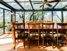 Sunroom dining on the second floor.  Seats 10. It is like dining in a treehouse.
