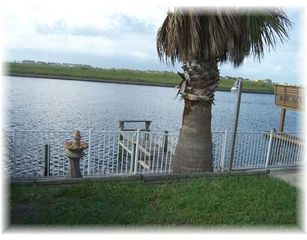 Relax out on the fishing pier. Underneath water light for night time fishing. - Corpus Christi condo vacation rental photo