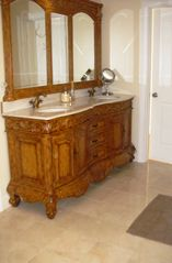 Brewster house photo - Second floor master vanity, Mable floors, Full tub and shower.